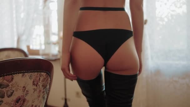Hot Sexy beautiful Sensual blonde woman with perfect slim body posing in black leather lingerie