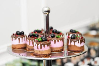 Three tier tray with cakes on the banquet table. Holidays and events