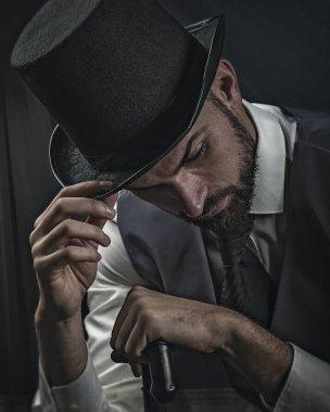 Gentleman in black hat, retro styled male portrait.