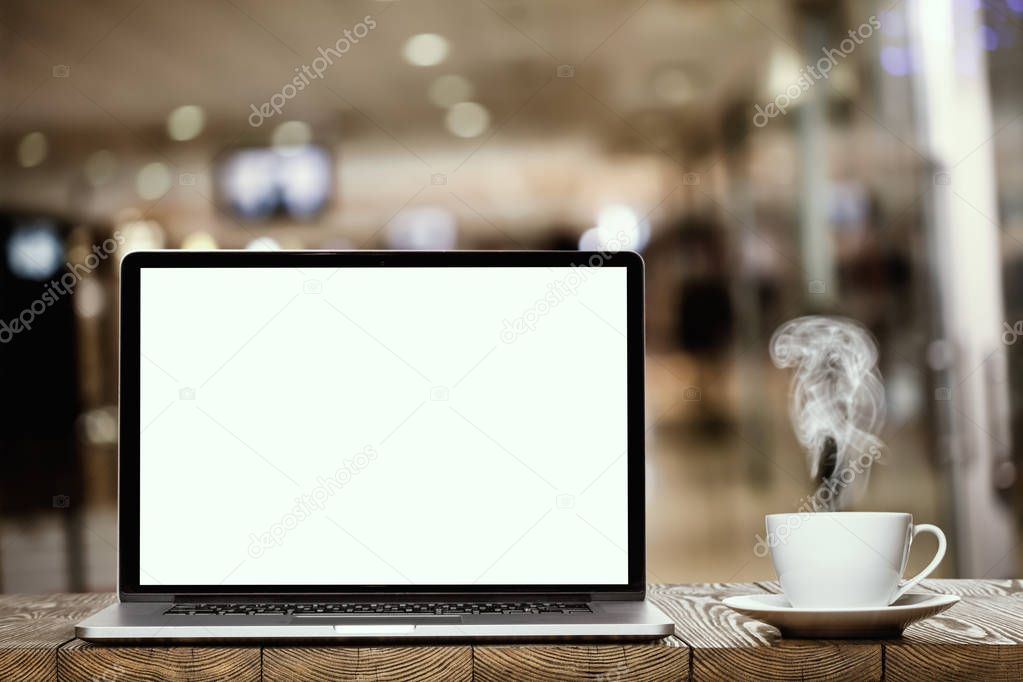 the modern laptop and coffee in the office