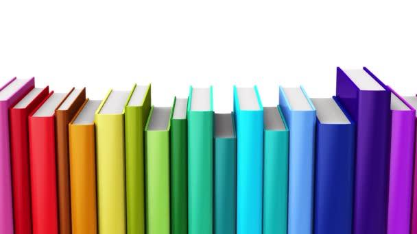Creative abstraktní věda, znalosti, vzdělání, zpět do školy, obchodní a podnikové splácení: 3d vykreslení bezešvé smyčka 4 k videozáznamu duhy barva knih izolovaných na bílém pozadí