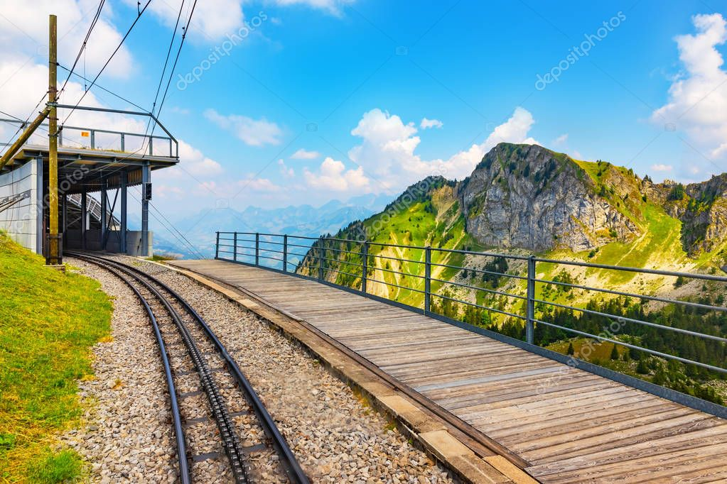 Scenic summer view of the cogwheel railway station on the way to Rochers de Naye mountain peak in Switzerland