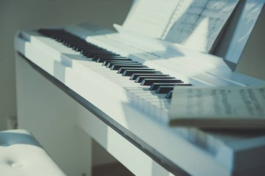 Closeup photo of electronic white piano at home
