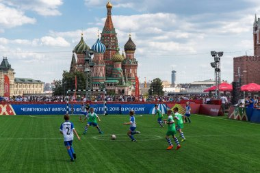 MOSCOW, RUSSIA - June 27, 2018: Children are playing football in the fan zone on Red Square during the World Cup