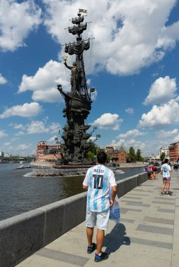 MOSCOW, RUSSIA - June 19, 2018: Football fan on the embankment of the river near the monument to Peter the Great