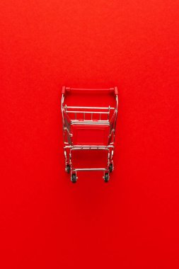 shopping trolley on red background