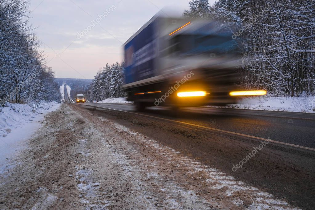 image of a truck on a winter road