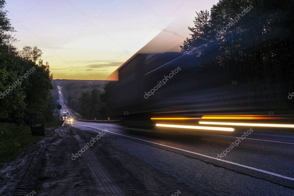 Moscow region, Russia - May, 18, 2019: night traffic on a highway in Moscow region, Russia