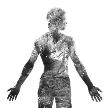 Double exposure, of a young shirtless man blended with tree bran