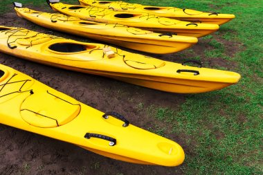 kayaks lie on the green lawn