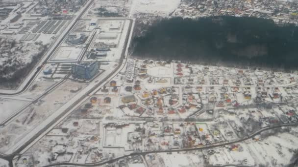 Snow over Moscow Region Suburban residential neighborhood houses district aerial view in 4k
