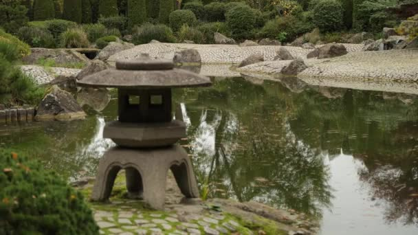 Cinemagraph of japanese garden with stone altar for kami-spirits of nature