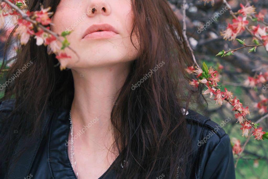 Low section of girls face enjoying sakura bloom