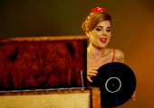 Photo Dj retro woman vintage vinyl turntable music. Girl pin-up style wearing red dress.
