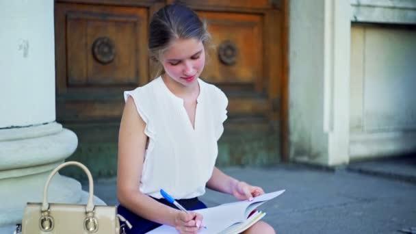 Higher education dreaming girl freshwoman student sitting on university steps