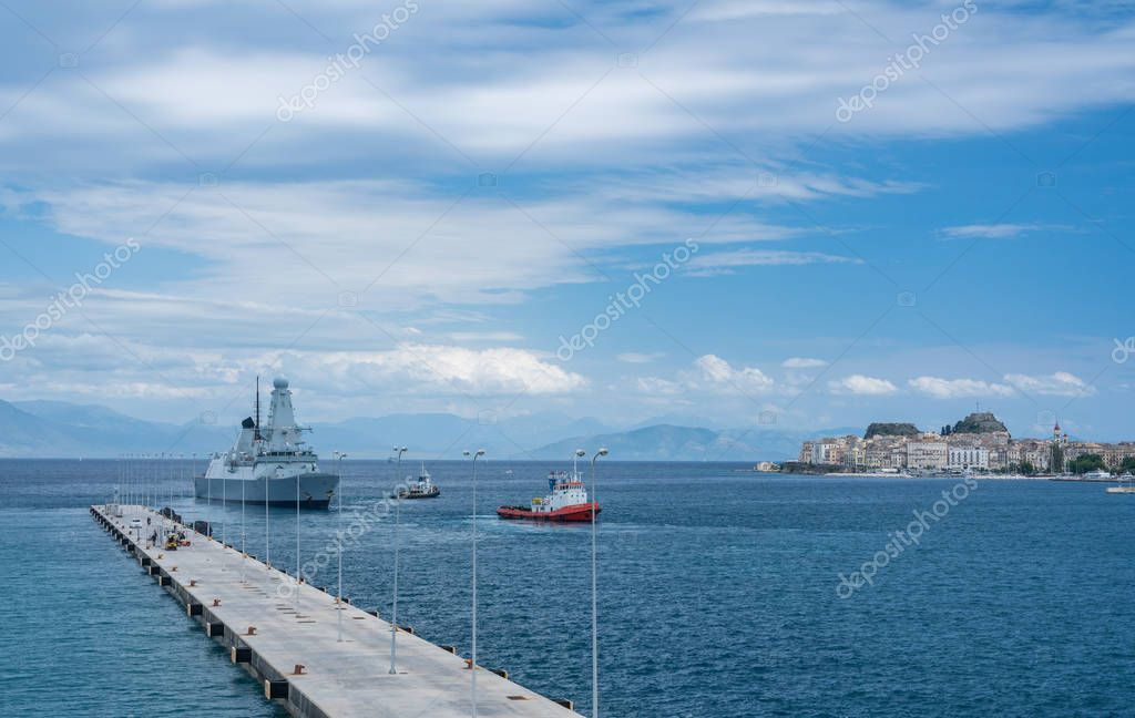 Royal Navy Destroyer HMS Duncan leaving harbor in Corfu