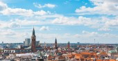 Fotografie Copenhagen city panoramic and aerial view on a cloudy day. Copenhagen, the capital city of Denmark. A lot of red roofs and bell towers are clearly visible all around. Travel and architecture concepts