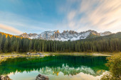 Lake Carezza or Karersee at sunset, wide angle view of scenic la