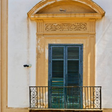 Italian Window in Palermo with Closed Wooden Shutters