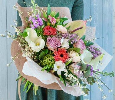 Nice bouquet in the hands stock vector