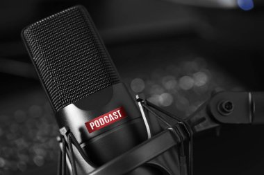 vocal microphone with podcast text close up