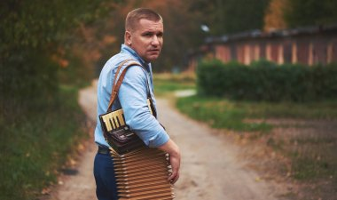 Russian man with accordion. Portable musical instrument, played by means of keys and buttons.