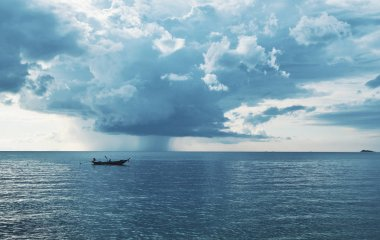 Longtail boat in a sea before the storm. Thailand, Phangan