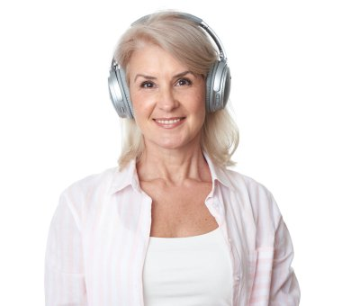 beautiful senior woman is listening to music isolated on a white