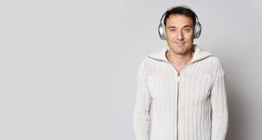 Happy man with headphones listening to music isolated