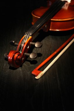 Nice violin and bow on dark wooden background