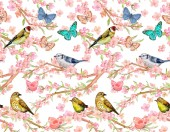 Photo seamless pattern with birds on twigs of flowering cherry and butterflies
