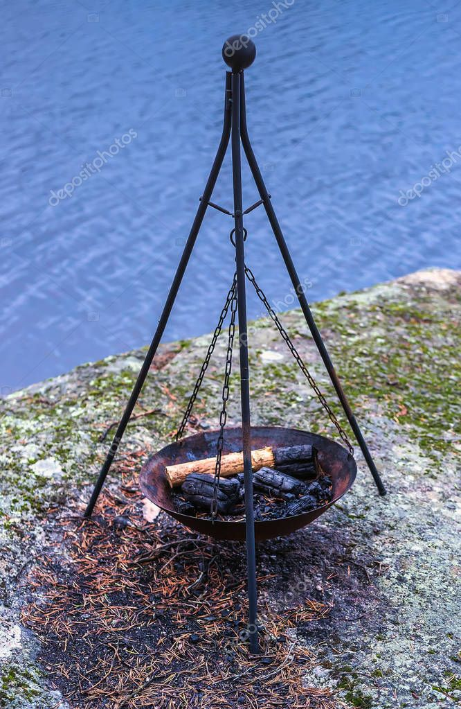 Fire pit on the coast of the lake in Finland