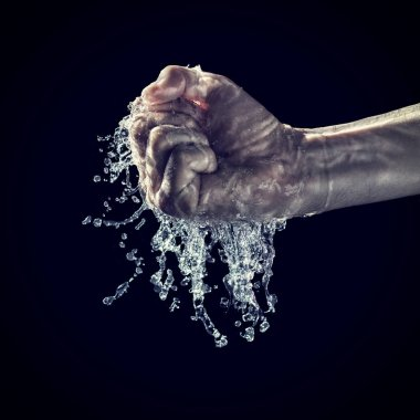 Human hands try to tighten water on black background stock vector