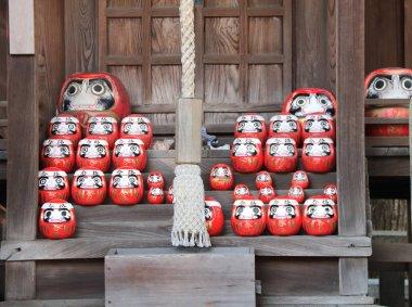 Traditional japanese daruma dolls in a shrine, Kurashiki city, Japan stock vector