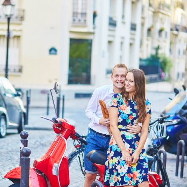 Romantic couple together in Paris walking on Montmartre