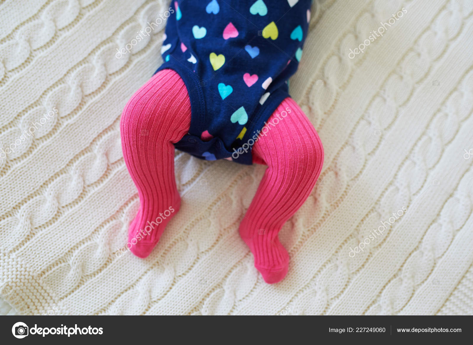 0fe8b38ae Baby girl wearing pink tights and colorful onesie. Child clothing and  apparel. Kids fashion — Photo by ...