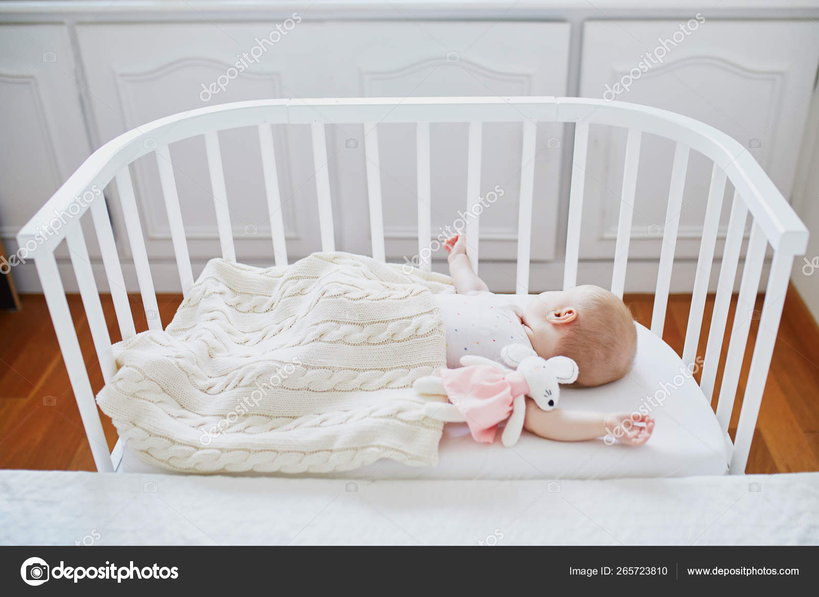 Baby Sleeping In Co Sleeper Crib Attached To Parents Bed Stock Photo C Encrier 265723810