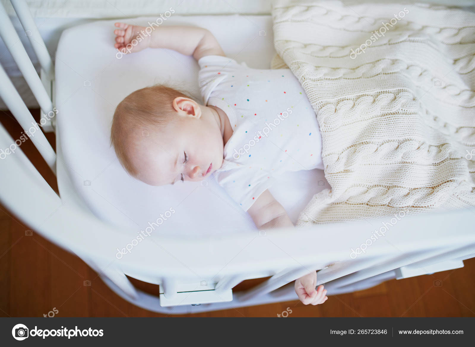 Baby Sleeping In Co Sleeper Crib Attached To Parents Bed Stock Photo C Encrier 265723846