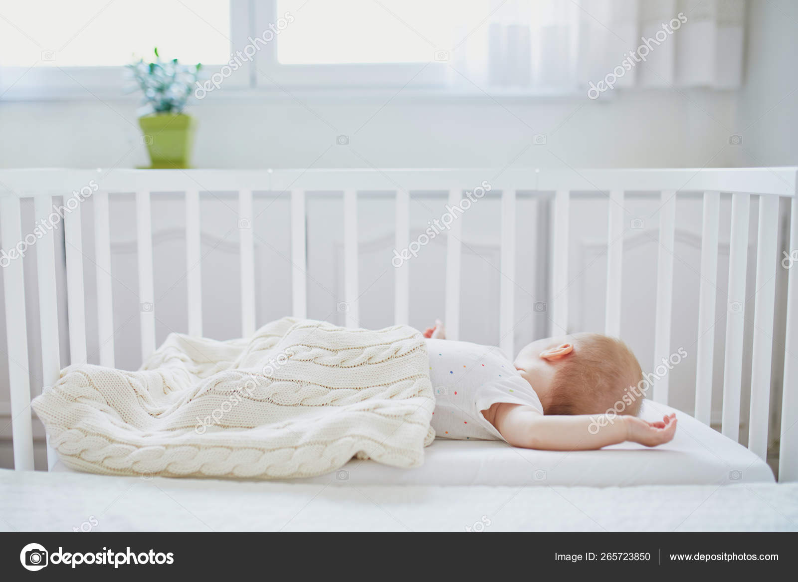 Baby Sleeping In Co Sleeper Crib Attached To Parents Bed Stock Photo C Encrier 265723850