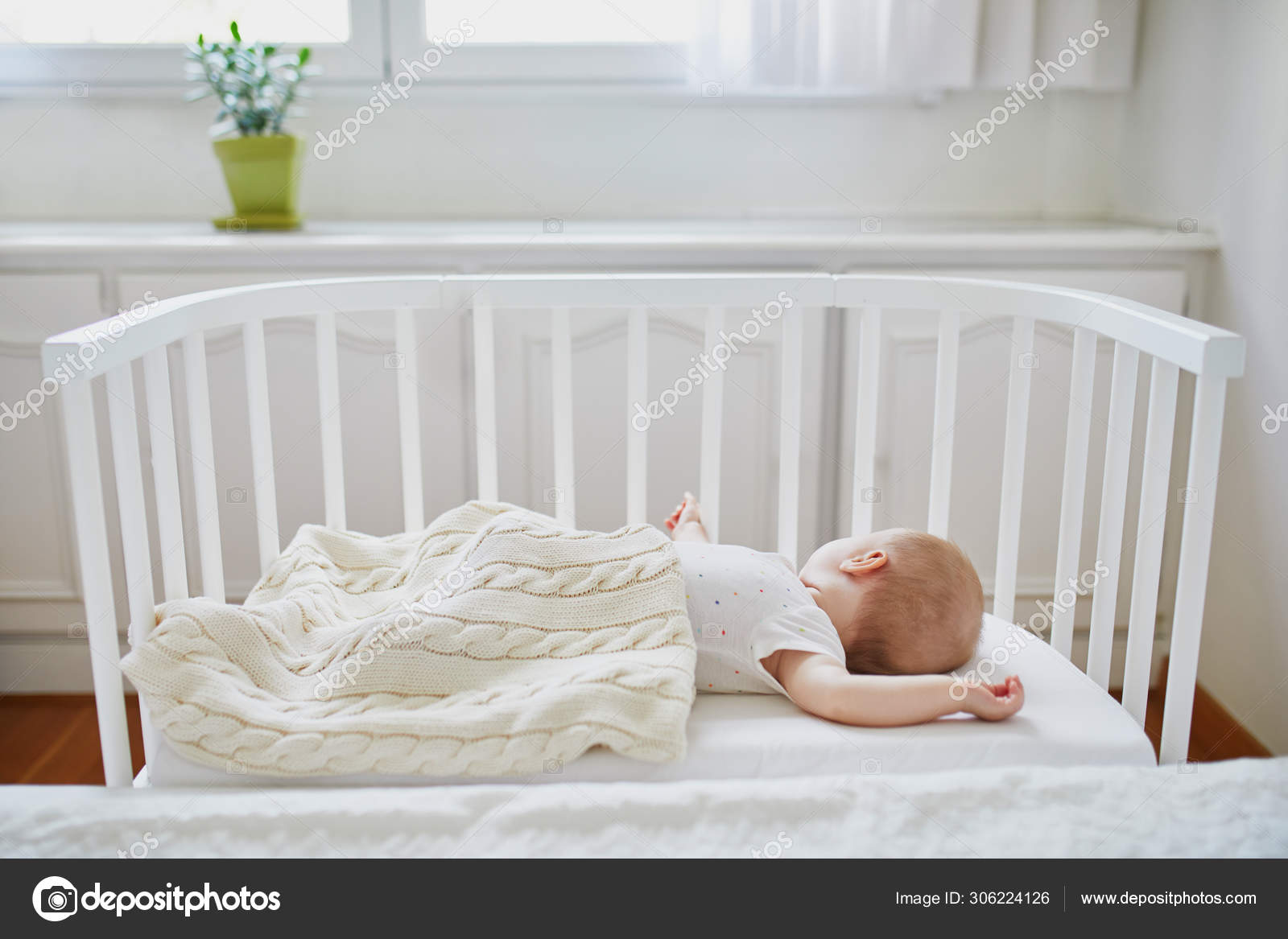 Baby Sleeping In Co Sleeper Crib Attached To Parents Bed Stock Photo C Encrier 306224126