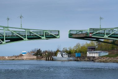 LATVIA, LIEPAJA - APRIL 30: Liepaja is a third largest city in the country located on the Baltic Sea. View to ship and part of swing bridge on 30 April 2020, Liepaja, Latvia.