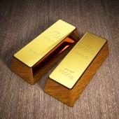 Zlaté cihly na dřevěné pozadí. Burzy a bankovní koncepce. 3D obrázek.