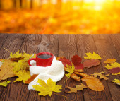 Autumn leaves and coffee.