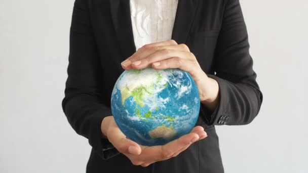 Business Woman holding the Planet in hands.