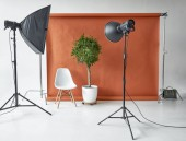 Photography studio equipment. Flashlights and paper backdrop