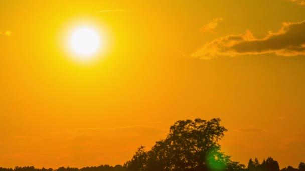Naplemente, nagy piros nap, idő-lapse