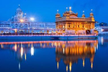 Sikh sacred site gurdwara Sri Harmandir Sahib also known as The Golden Temple, also Darbar Sahib illuminated at night. Amritsar, Punjab state, India stock vector