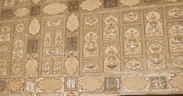 Exterior of the Wall of the Mirror Room Inside Sheesh Mahal in Amer (Amber) Palace complex. Amer, Rajasthan, India. Horizontal camera pan