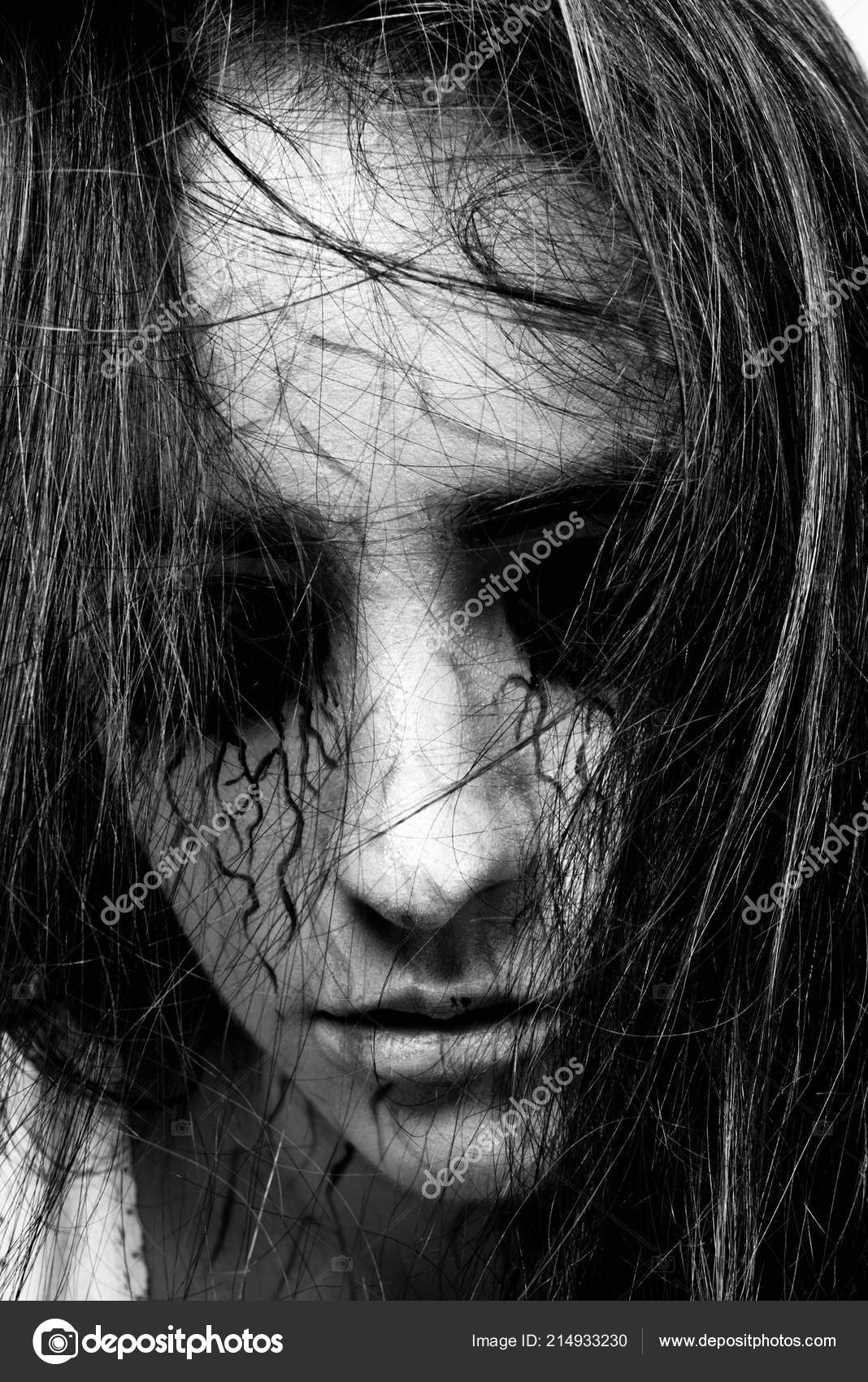 Black and white portrait of a girl with black eyes and black veins closeup madness and obsession with spirits concept of halloween and day of the dead