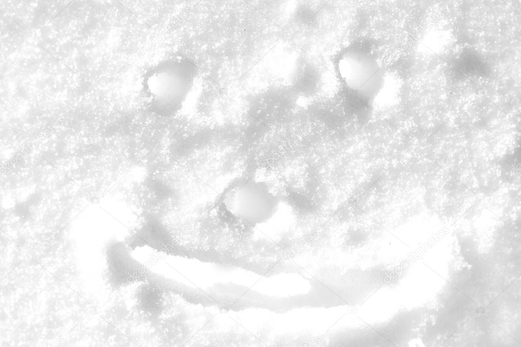 smiley face drawn on snow